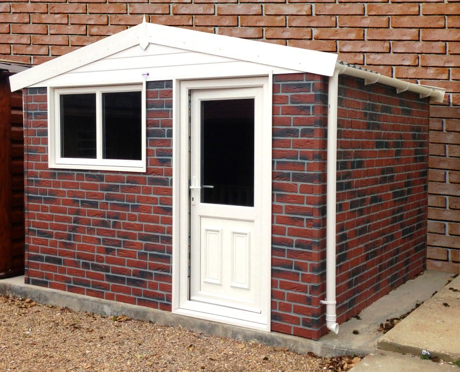 Garden building range gallery hanson concrete garages for Brick garden shed designs